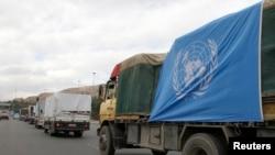 БҰҰ-ның гуманитарлық көмегін тасымалдап бара жатқан көліктер. Сирия, 13 қаңтар 2014 жыл.