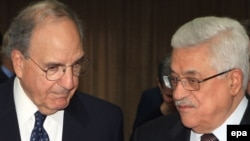 Palestinian Authority President Mahmud Abbas (R) with U.S. Middle East envoy George Mitchell in Ramallah in July