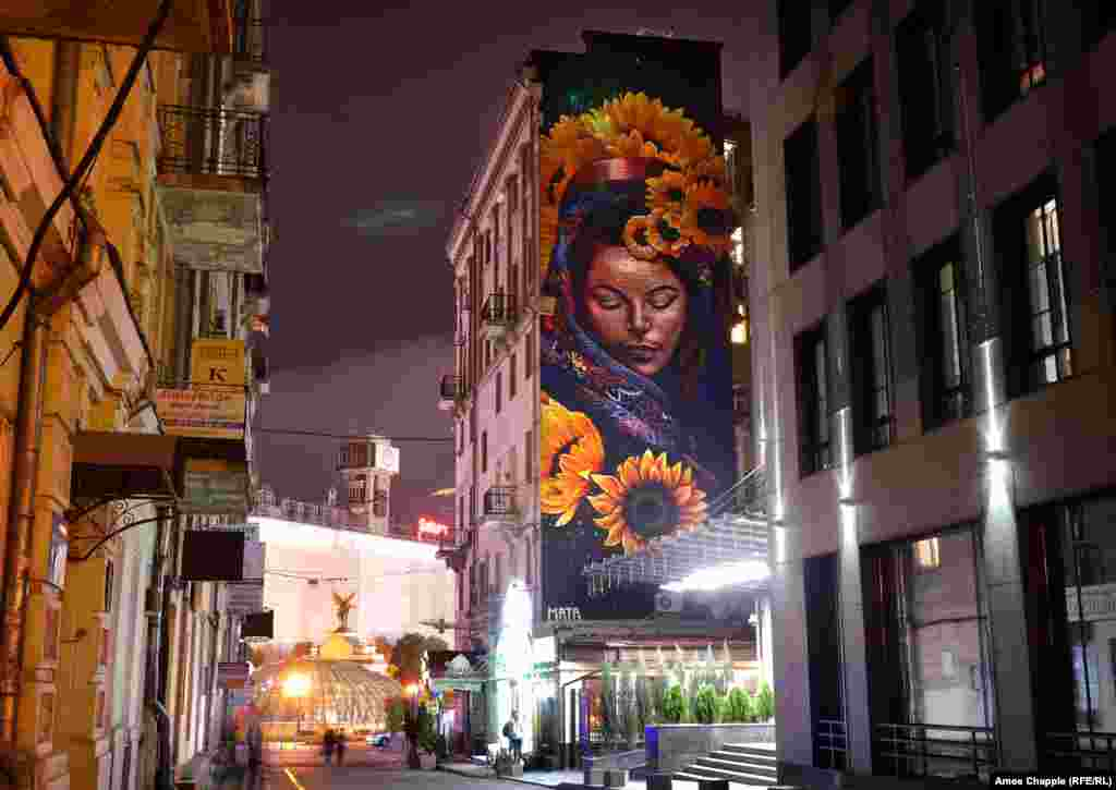 "At the opposite end of Maidan is ""Protectress,"" by Costa Rican artist Mata Ruda. The mural depicts a Slavic goddess surrounded by sunflowers, the national flower of Ukraine."