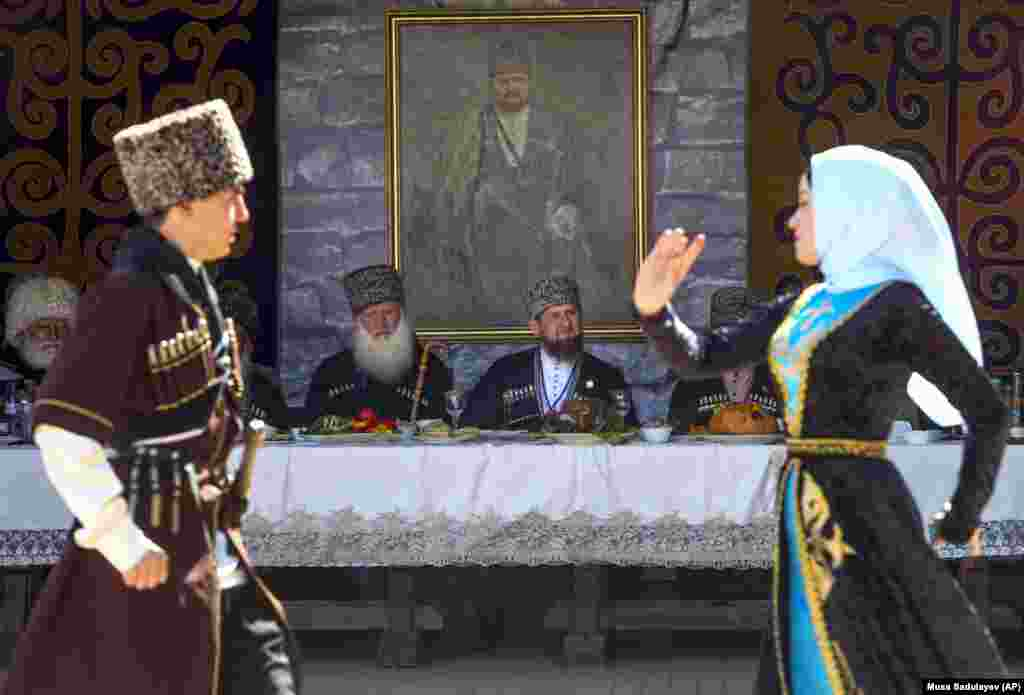 In traditional dress, Chechen leader Ramzan Kadyrov watches a dance performance during celebrations for the Day of the Chechen Language in Grozny on April 25. (AP/Musa Sadulayev)