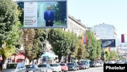 Armenia - An election campaign billboard of mayoral candidate Arkadi Peleshian on Vanadzor's central street, 2Oct2016.