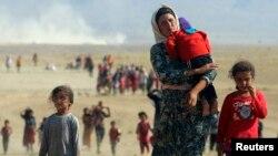 Күрдістандағы ИМ шабуылдары кесірінен босқын тапқан езидтер. 2014 жылдың тамызы. (Көрнекі сурет)