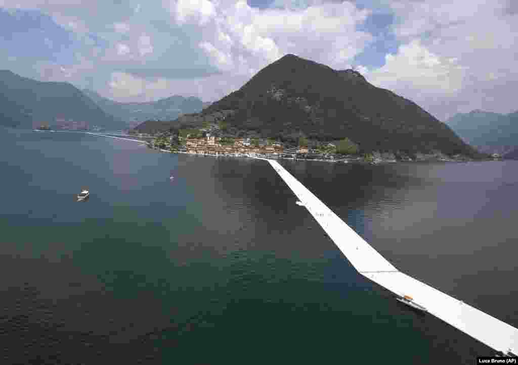 An aerial view of the installation of The Floating Piers by Christo on Lake Iseo in northern Italy in June 2016. Some 200,000 floating cubes created a 3-kilometer runway that was clad in bright yellow fabric and connected the town of Sulzano to the small island of Monte Isola.
