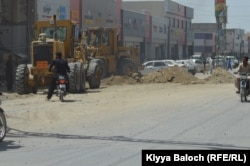 A city street is being construction by the deputy commissioner Turbat.