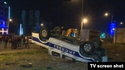 A police car is overturned during protests in Batumi, Georgia.