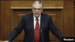 Greece -- Greece's Prime Minister Lucas Papademos addresses parliamentarians before a vote of confidence at the parliament in Athens, 16Nov2011