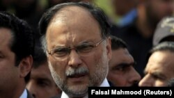 FILE: Pakistan Muslim League Nawaz (PML-N) leader Ahsan Iqbal is accused of corruption in relation to a sports-complex project.