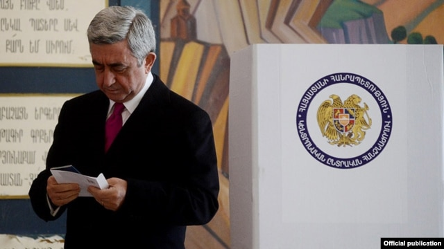 Armenian President Serzh Sarkisian just before casting his ballot in the presidential election on February 18, which official returns suggest he won with more than 58 percent of the vote.