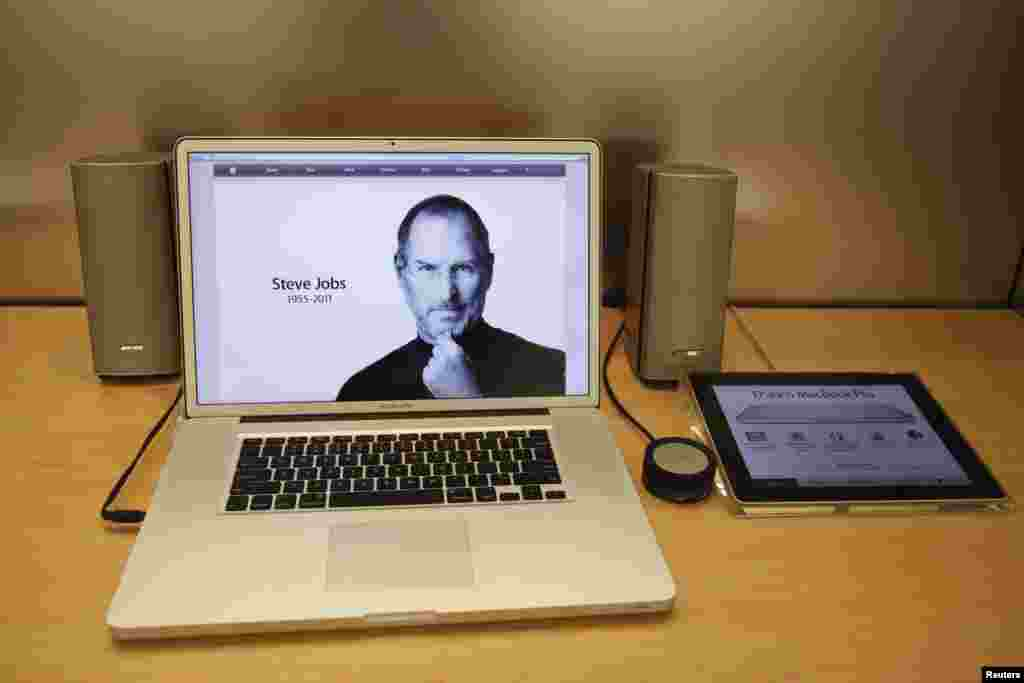 A MacBook Pro laptop computer at an Apple store in California displaying the death announcement for former Apple CEO Steve Jobs on October 5, 2011.