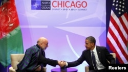 U.S. President Barack Obama (right) hosts a meeting with Afghan President Hamid Karzai during the NATO Summit at McCormick Place in Chicago on May 20.