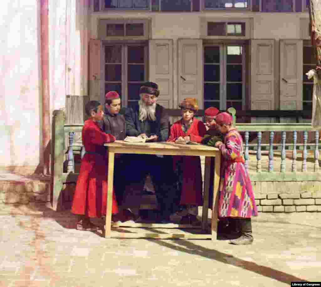 Jewish children study with their teacher in Samarkand, home to a religiously diverse population.