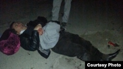 Ikramidin Aitkulov lies on the ground after the attack, from image on Facebook page of his brother Khansari Aitkulov.