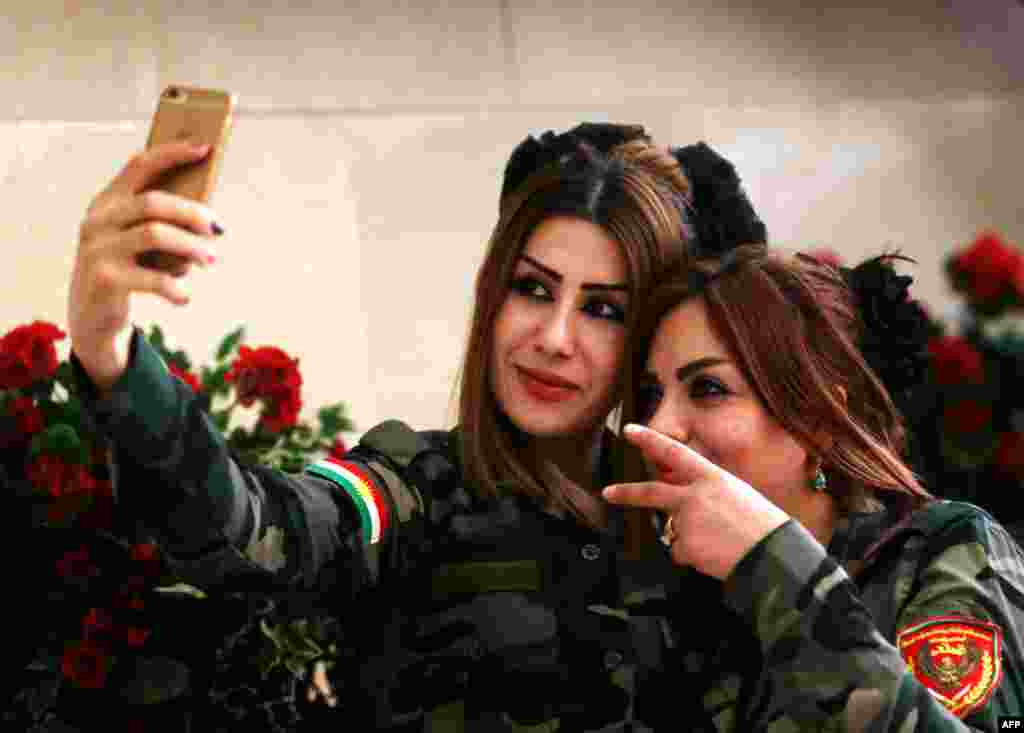 Female Peshmerga fighters take a selfie in Irbil, the capital of the Kurdish autonomous region. (AFP/Safin Hamed)