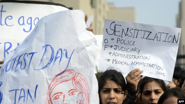 Indian lawyers shout slogans as they hold placards during a protest at the entrance to Saket District Court in New Delhi earlier this month.