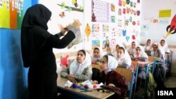 A female instructor teaching girls in an all-girl school in Iran. All schools are gender-segregated in Iran. File photo