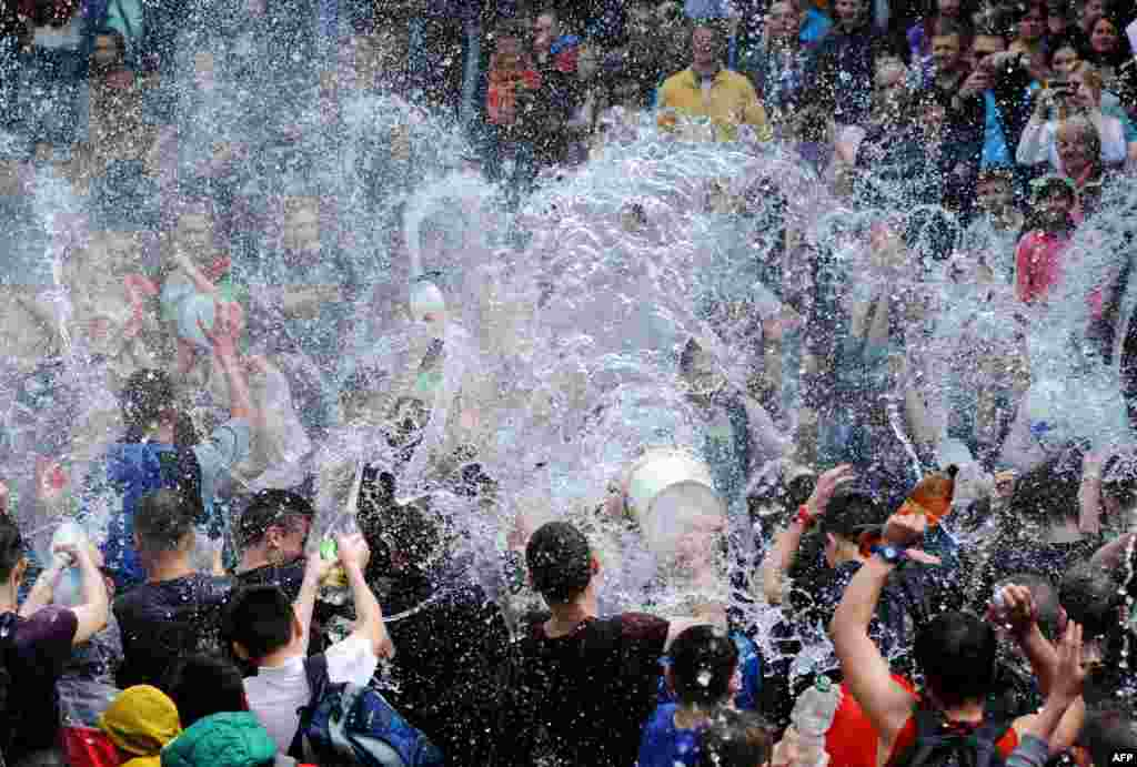 People spray water on one another as they celebrate Clean Monday (or Wet Monday) in Lviv, Ukraine, on May 2. (AFP/Yuriy Dyachyshyn)