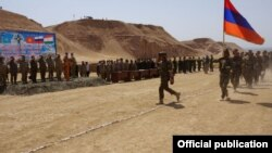 Tajikistan - Armenian soldiers march during a CSTO military exercise near the Afghan border, 19May2015.