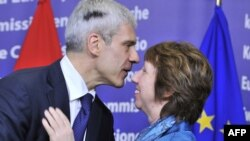 Serbian President Boris Tadic (left) greets EU foreign policy chief Catherine Ashton after giving a press conference in Brussels on February 27.