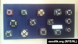 Traditional Uzbek skullcaps on display in the country's Museum of Applied Arts. As cheap Chinese versions of these types of products become more widely available, some fear that museums will soon be the only place where traditional craft items like these can be found.