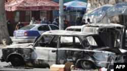Burned cars on the streets of Yerevan on March 2, 2008