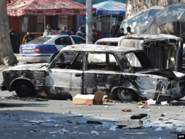 A burned-out car on a street in the captial, Yerevan, following deadly clashes between riot police and opposition protesters on March 1, 2008.