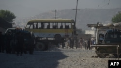 The minibus being taken away following the suicide attack in Kabul.