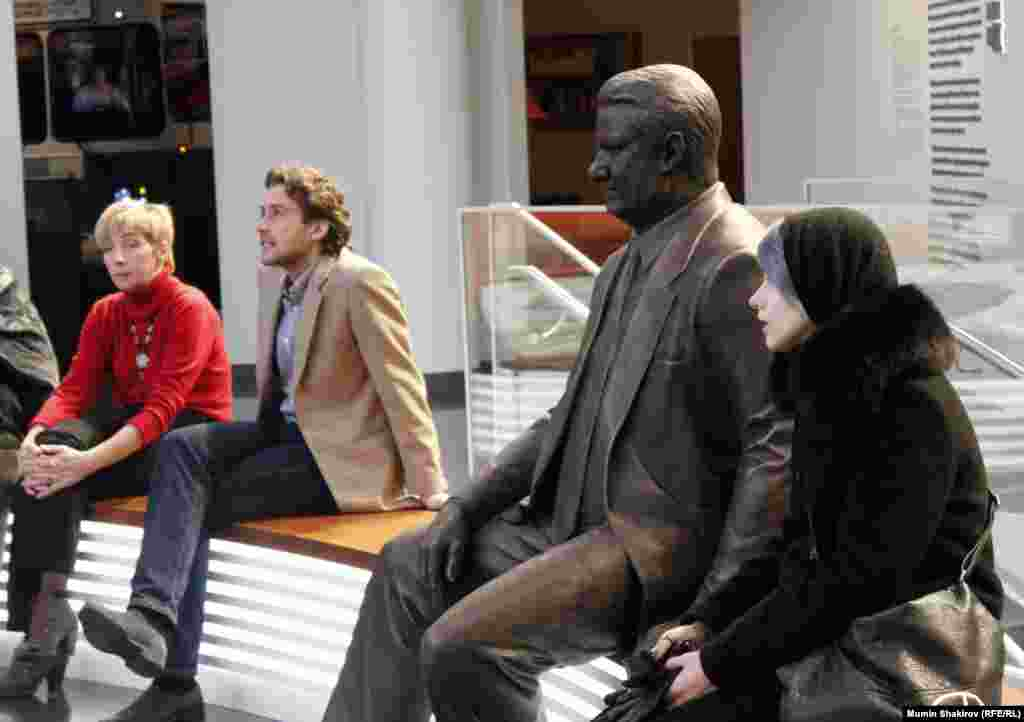 Visitors pose for snaps by a bronze statue of Yeltsin.