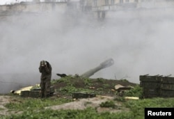 An ethnic Armenian serviceman launches artillery toward Azerbaijani forces from the town of Martakert in Nagorno-Karabakh on April 3.
