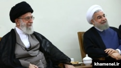Iran's Supreme Leader Ayatollah Ali Khamenei (L), and Iranian President Hassan Rouhani attend Supreme Leader's meeting, 24Aug2016