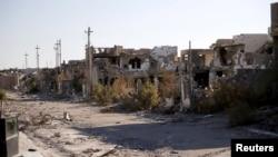 Разрушенные в результате боев здания в иракском городе Рамади. 16 января 2016 года.