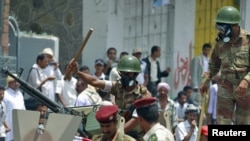 Soldiers block an antigovernment demonstration in the southern city of Taiz on April 7.