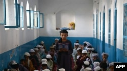 Afghan boys study the Koran at a madrasah during the month of Ramadan in Kandahar.