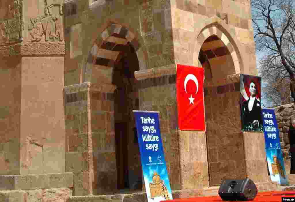 A Turkish flag and a picture of Turkish leader Mustafa Kemal Ataturk at the entrance to the church during a ceremony marking the end of its renovation in 2007.