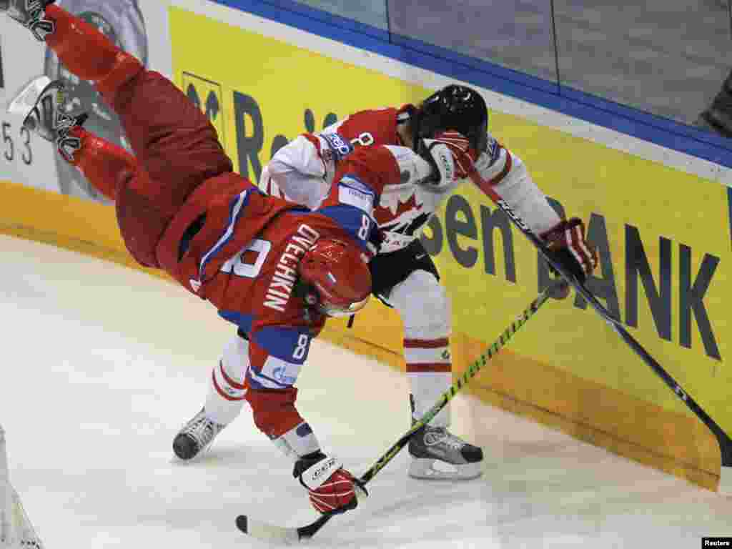 Russia's Alexander Ovechkin collides with Canada's Brent Burns during the quarterfinals of the 2010 World Hockey Championships in Cologne, Germany. Photo by Grigory Dukor for Reuters