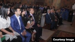 Armenia - Prime Minister Hovik Abrahamian and his son Argam (second from left) attend the consecration of a church built by them in Artashat, 31 May2015.