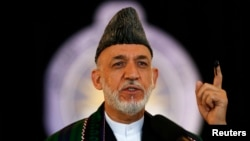 Afghanistan -- Afghan President Hamid Karzai speaks after voting in the presidential election in Kabul June 14, 2014. Afghans headed back to the polls on Saturday for a second round of voting to elect a successor to President Hamid Karzai in a decisive te