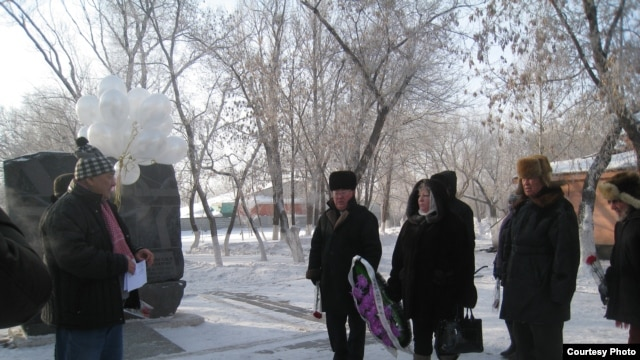 Activists lay flowers in memory of victims of the Zhanaozen unrest in the Kazakh city of Karaganda.
