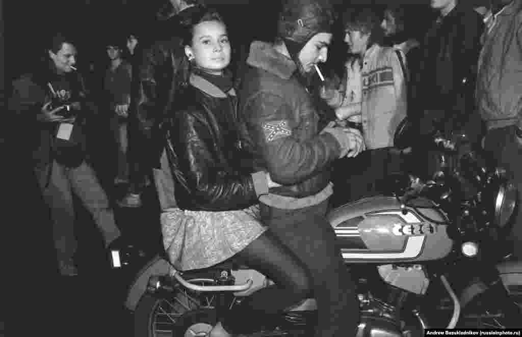 The kids are Russian, the motorbike is Czech, but the flag is Confederate: Bikers on the streets of Moscow in 1989.