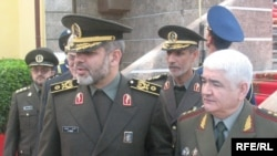 Sherali Khayrulloev, Tajikistan's minister of defense (right) and his Iranian counterpart, Ahmad Vahidi, in Dushanbe today