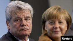 "The ""Suddeutsche Zeitung"" article claimed President Joachim Gauck's decision came after consultations with Chancellor Angela Merkel."