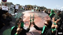 Supporters of opposition leader Mir-Hossein Musavi at a renewed protest demonstration in Tehran.