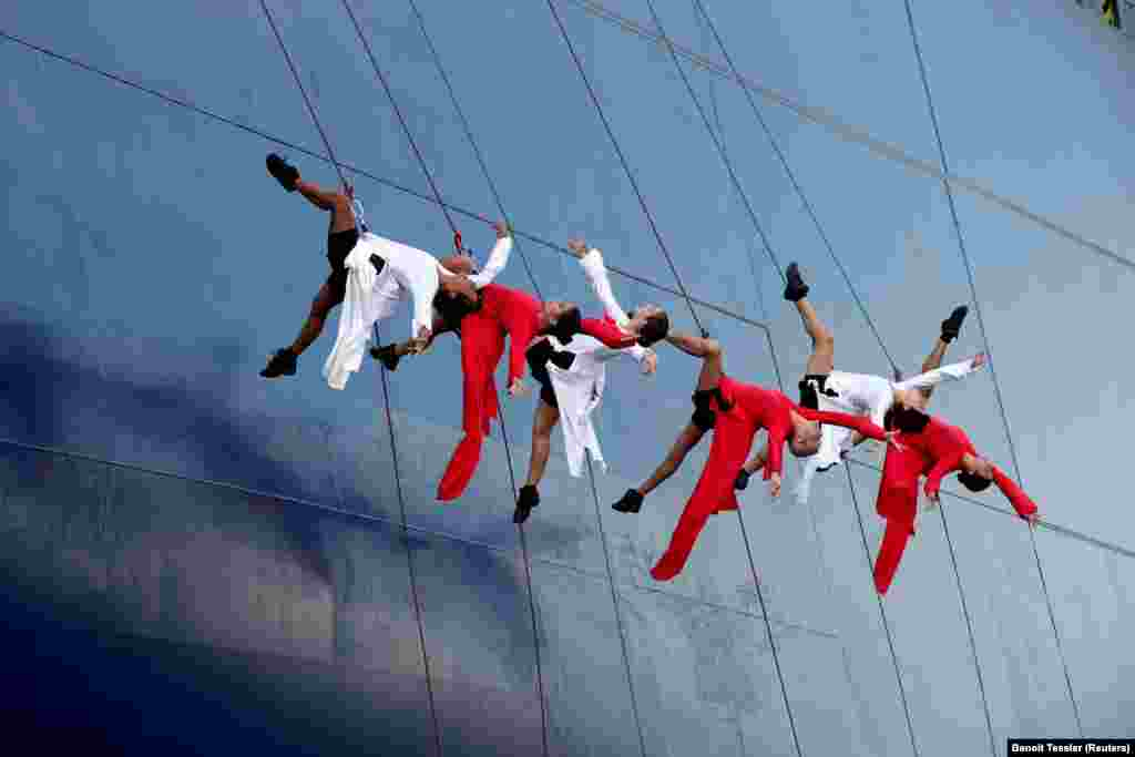 A group of dancers performs during the launch of a container ship in Le Havre, France.  (Reuters/Benoit Tessier)