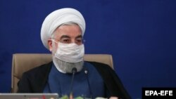 A handout photo made available by the presidential office shows Iranian President Hassan Rouhani wearing face mask during the cabinet meeting in Tehran, Iran, 08 July 2020.