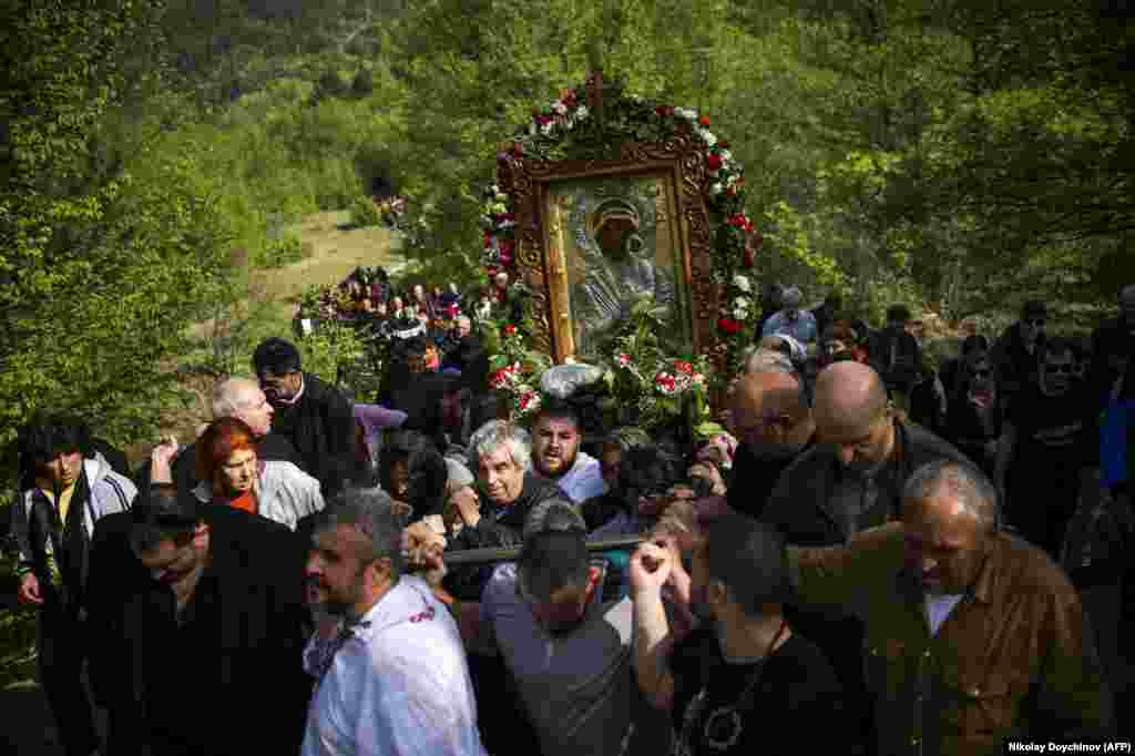 Pilgrims carry an icon of the Virgin Mary during the annual religious procession, marking the second day of Orthodox Easter at the Bachkovo monastery in Bulgaria on April 29. (AFP/Nikolay Doychinov)