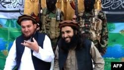 FILE: Tehreek-e Taliban Pakistan (TTP) spokesman Ehsanullah Ehsan (L) and with new TTP leader Adnan Rasheed in February 2013