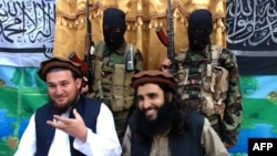 Tehreek-e-Taliban Pakistan (TTP) spokesman Ehsanullah Ehsan, left, and with TTP member Adnan Rasheed in 2013