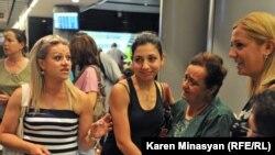 Syrian-Armenian refugees arrive in Yerevan on August 17.