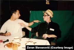 Zoran Stevanovic (left) and French journalist Paul Marchand sit in the Holiday Inn.