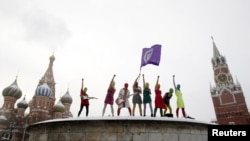 Members of the radical feminist group Pussy Riot perform on Red Square in Moscow in January