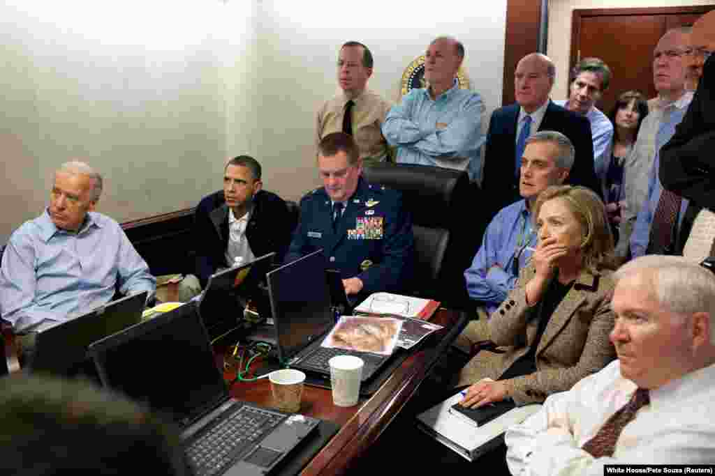U.S. President Barack Obama (second from left) and Vice President Joe Biden (left), along with members of the national security team, receive an update on the mission to capture or kill Osama bin Laden, in the Situation Room of the White House, May 1, 2011. (Reuters/White House/Pete Souza)